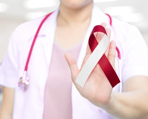 doctor with oral cancer awareness ribbon